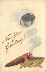 NEW YEAR GREETINGS   smoke from cigar surrounds photo-inset of girl looking left/front