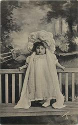 girl standing outside on porch with night clothes on