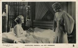 MADELEINE CARROLL AND KAY HAMMOND  woman left sits in bed, other one right looks at her angry