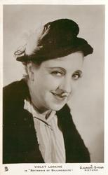 """VIOLET LORAINE IN """"BRITANNIA OF BILLINGSGATE""""  faces right, looks front, wears hat with feather"""