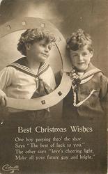 BEST CHRISTMAS WISHES two boys, boy on left holds large fake horseshoe and wears light coloured sailor shirt