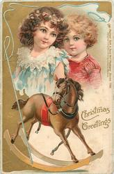 CHRISTMAS GREETINGS  boy & girl above rocking horse, whip surrounds