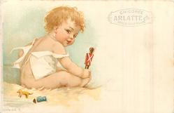 baby playing with wooden soldier