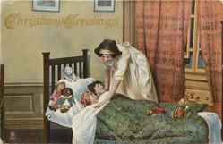 CHRISTMAS GREETINGS  mother tucks in two children, toys & golly on pillow