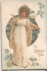 TO GREET YOU woman in dress surrounded by forget-me-nots