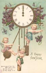 A HAPPY NEW YEAR in gilt below 3 angels swinging on workings of clock at midnight, violets around