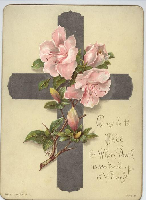 silver cross with pink flowers on branch