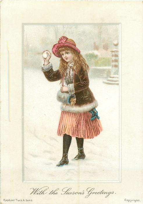 girl throws snowball