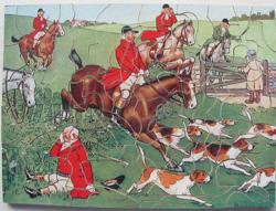 IN FULL CRY, huntsmen on horseback take the jumps, hounds in front