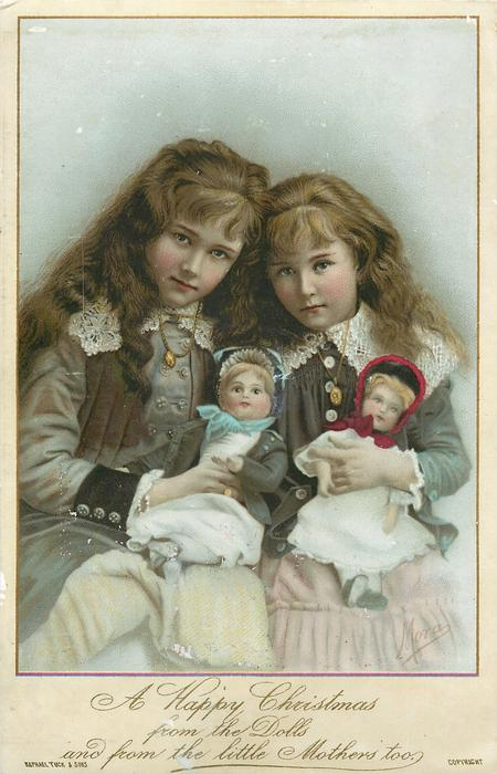 two girls sit with dolls on their laps