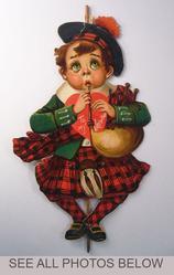 Scottish boy playing bagpipes