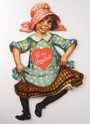 dancing girl wearing blue polka dot dress and red hat