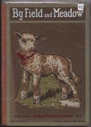 BY FIELD AND MEADOW brown and white lamb with red collar
