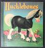 HUCKLEBONES black pony with white mane, tail and feet