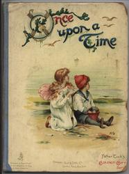 ONCE UPON A TIME boy and girl sit at seaside with bucket and spade