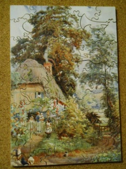 THE COTTAGE IN  THE LANE, mother and children at a fence, cottage and English garden