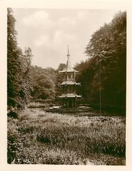 three tiered monument in pond
