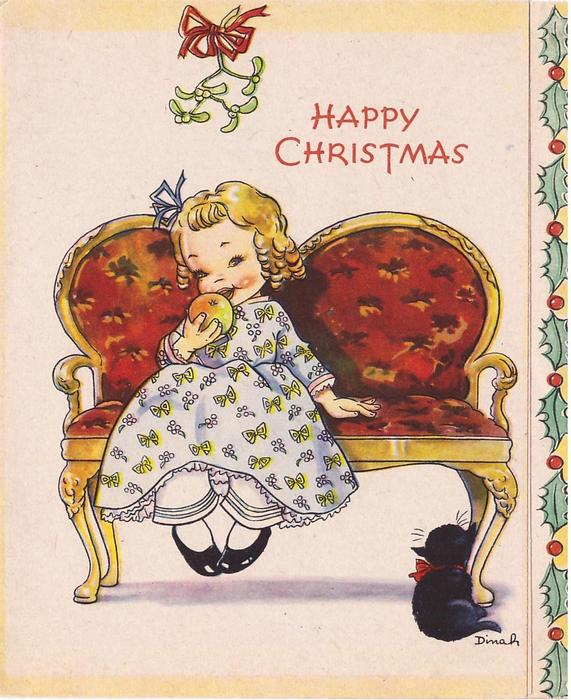 HAPPY CHRISTMAS girl sits on sette with apple, mistletoe above, cat right