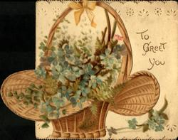 TO GREET YOU right, sprays of blue forget-me-nots in wicker basket