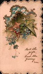 NOT THE GIFT BUT THE GIVING, below sprays of blue forget-me-nots, & 3 ivy leaves above