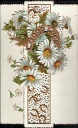 GOOD LUCK in perforated gilt horseshoe surrounded by white daisies with yellow centres
