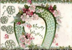 HEARTY GREETINGS in green horseshoe on left flap, pink forget-me-nots on both flaps, perforations left