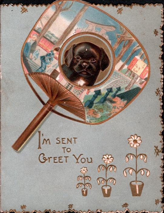 I'M SENT TO GREET YOU head & shoulders of black Japanese dog inset into ornate decorated gilt fan