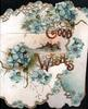 GOOD WISHES in gilt, blue daisies & rural inset on left flap, more flowers on right flap