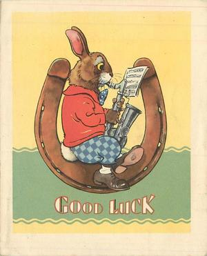 GOOD LUCK rabbit, facing right, sits in horseshoe playing saxophone, yellow & green background
