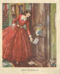 CHRISTMAS GREETINGS woman in red dress receives letters through mailslot in door