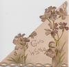 GOOD WISHES in gilt, violets upright on triangular shaped card, performations in scalloped edge design