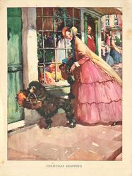 CHRISTMAS SHOPPING woman in front of shop window preceded by her black poodle carrying a basket