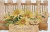 GOOD WISHES in gilt below,  perforated fence design  above yellow daisies  embossed