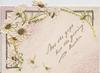 """""""NOT THE GIFT BUT THE GIVING"""" in gilt, white daisies above left, heavily perforated & glittered, embossed"""