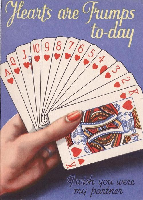 HEARTS ARE TRUMPS TO-DAY -- I WISH YOU WERE MY PARTNER woman's hand holds full house of cards, blue background
