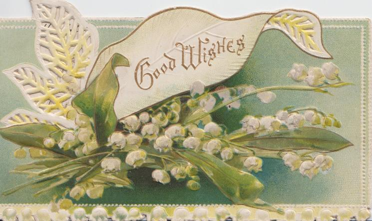 GOOD WISHES in gilt in white upper inset, lilies of the valley below & along bottom margin, perforated leaf left, green background