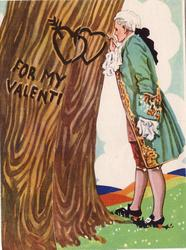 FOR MY VALENTINE man in old-style dress carves hearts on tree trunk