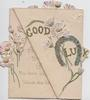 GOOD LUCK letters & horseshoe glittered, pale pink daisies on front flap, other pink daisies across the.rest of the card