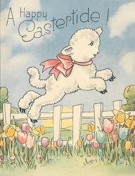 A HAPPY EASTERTIDE! lamb wearing pink bow jumps over fence right, tulips and daffodils in foreground