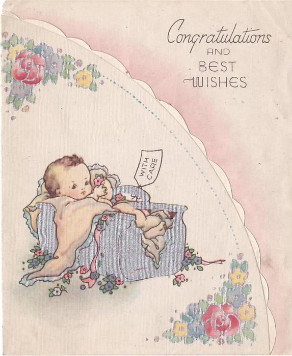 CONGRATULATIONS AND BEST WISHES baby in silver cradle tagged WITH CARE, flowers surround