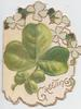 GREETINGS in gilt below clover leaves & stylised clover design, almost oval shape