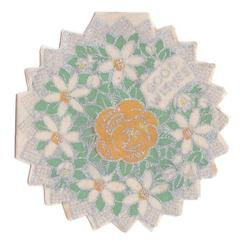 GOOD WISHES silvered die-cut floral wreath of white flowers, orange flower in centre