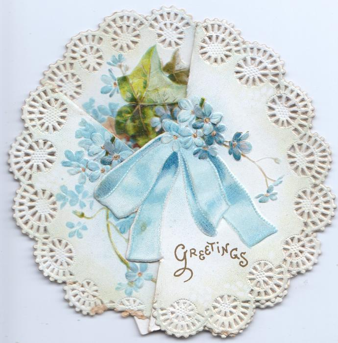 GREETINGS in gilt at base of right flap below blue bow, forget-me-nots & ivy around, card cut & folded to circular design