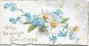 WITH HEARTY GREETINGS in gilt below forget-me-nots & white & yellow daisies, stylised floral design upper right
