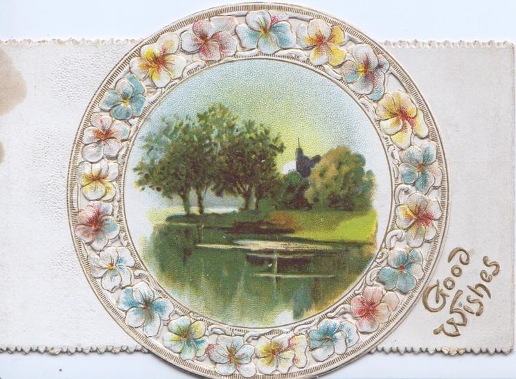 GOOD WISHES in gilt bottom right, stylised floral forget-me-not circular design round rural inset of water, trees & church