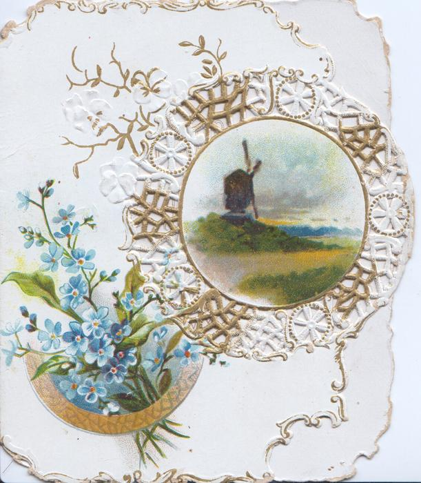 no front title, perforated circular design round rural inset with windmll, forget-me-nots below left