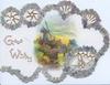 GOOD WISHES, perforated circular edge designs of forget-me-nots & 2 silver bells round rural inset with windmll, river & bridge