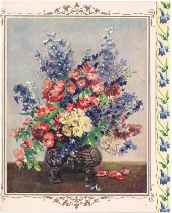 no front card title, footed vase with mixed flowers, flower petals on table, panel of blue flowers right