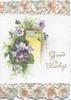 GOOD WISHES in gilt,  purple & white pansies in front of sunlit gilt framed inset, stylised pansies in perforated top & bottom designs