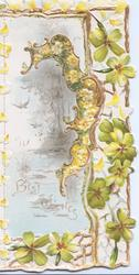 right, glittered BEST WISHES in gilt at base of watery inset, yellow primroses perforated gilt & primrose design on left flap, more primroses right
